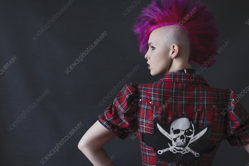 Young woman with pink mohawk