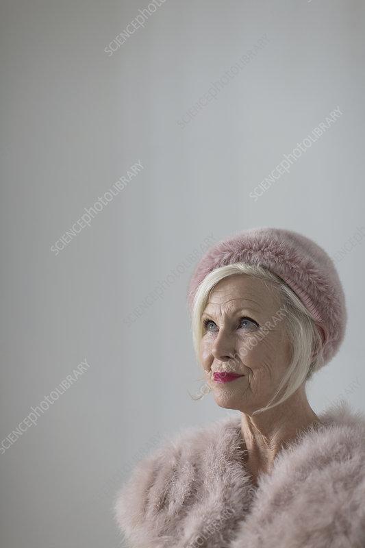 Portrait elegant senior woman wearing pink fur