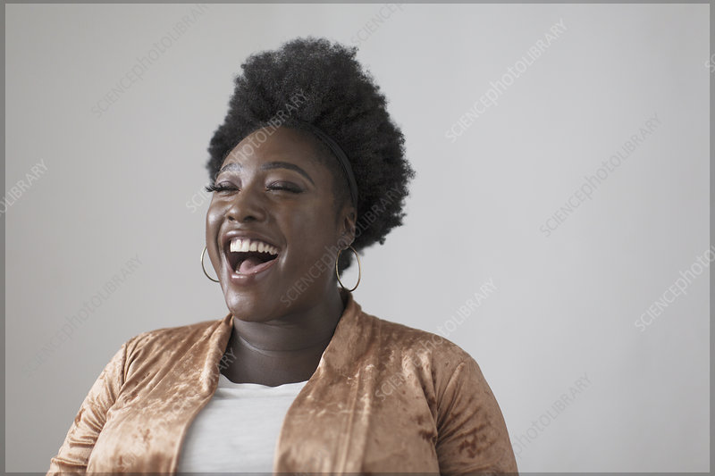 Carefree woman laughing