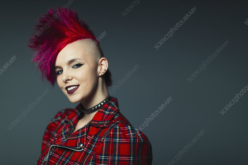 Portrait cool young woman with pink mohawk