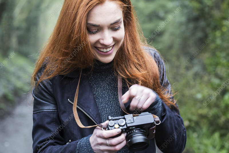 Woman taking pictures with vintage camera