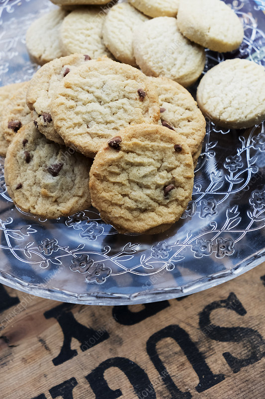 High angle chocolate chip cookies on a glass plate
