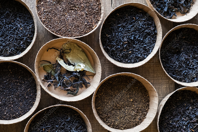 Selection of tea leaves in small wooden bowls