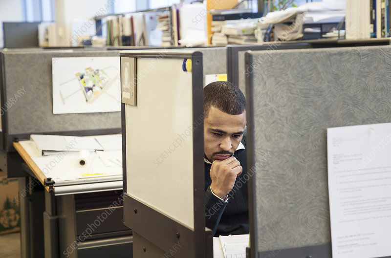 Man working in his cubicle in an corporate office