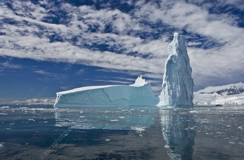 Iceberg reflected in sea, Fournier Bay, Antarctica