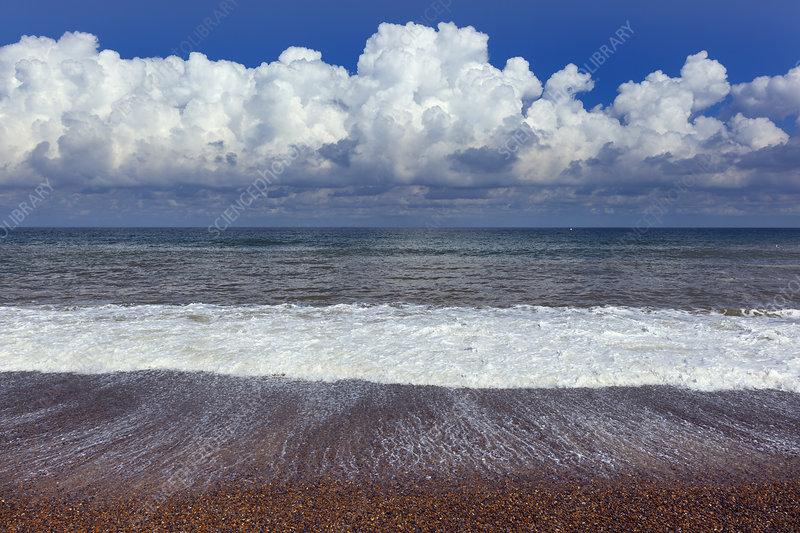Waves washing onto Weybourne beach, Norfolk, UK