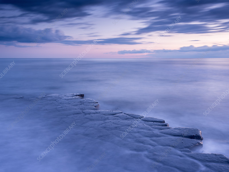 Kimmeridge Bay, ledges at twilight, The Purbecks, Dorset, UK