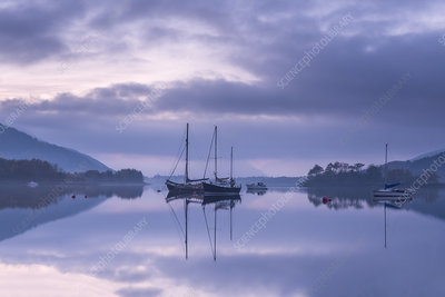 Loch Leven, boats and reflections at dusk, Scotland, UK