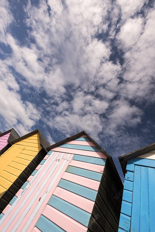 Colourful beach huts and sky, Bude, Cornwall, UK