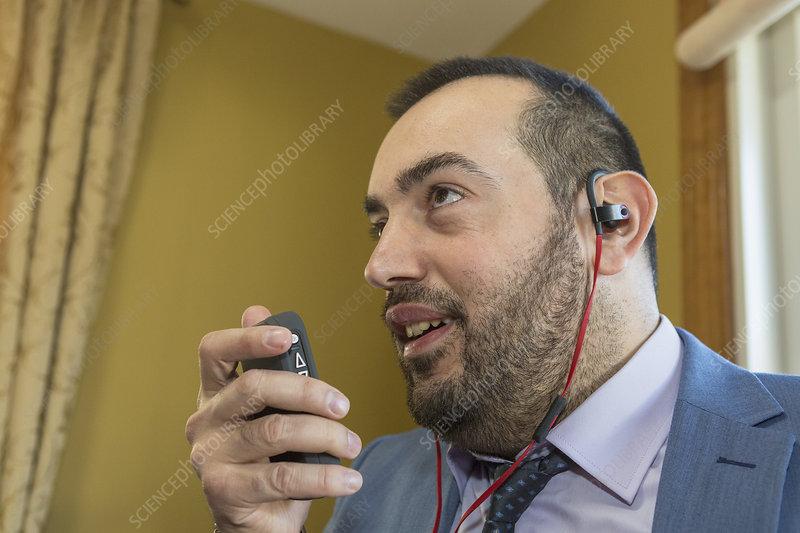 Businessman with visual impairment using phone