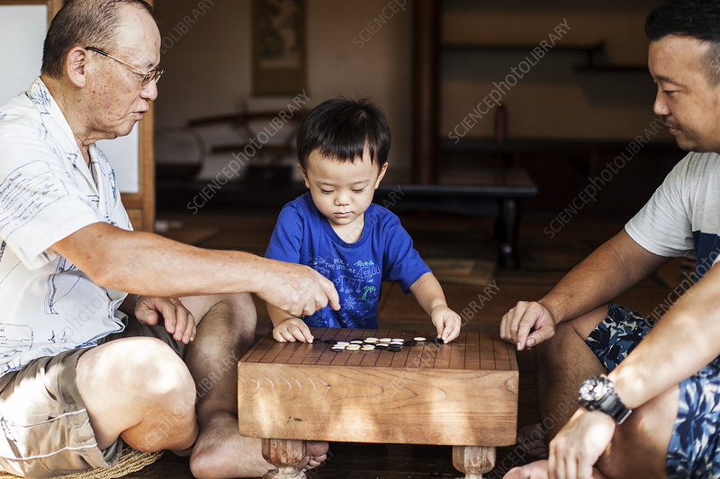 Two Japanese men and little boy playing Go