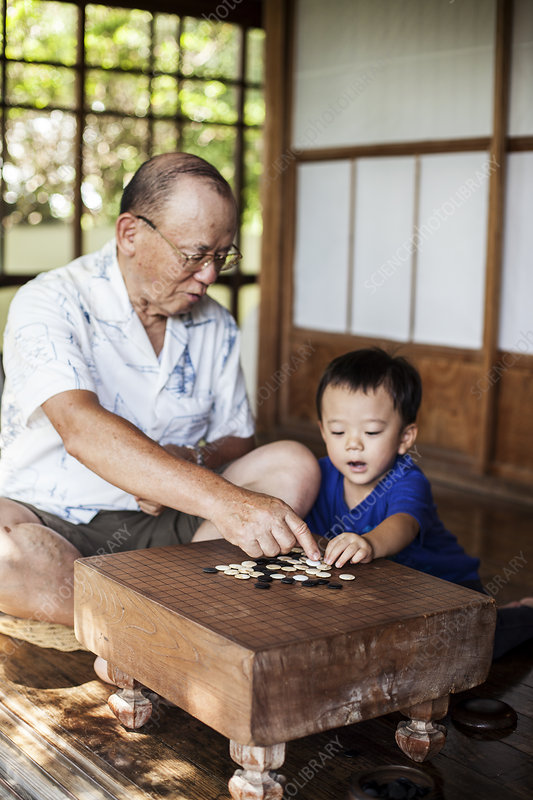 Japanese man and little boy playing Go