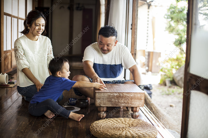 Japanese woman man and little boy playing Go