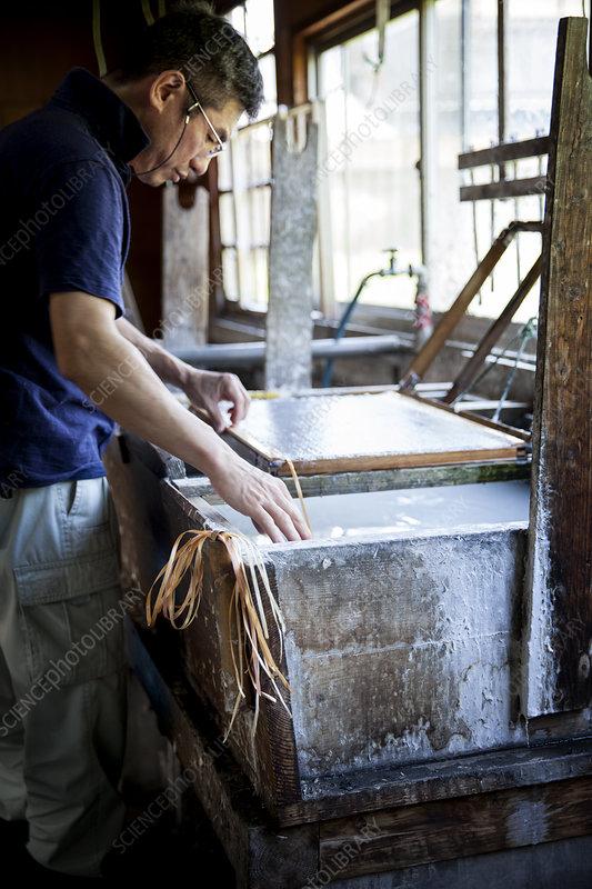 Japanese man in a workshop making Washi paper