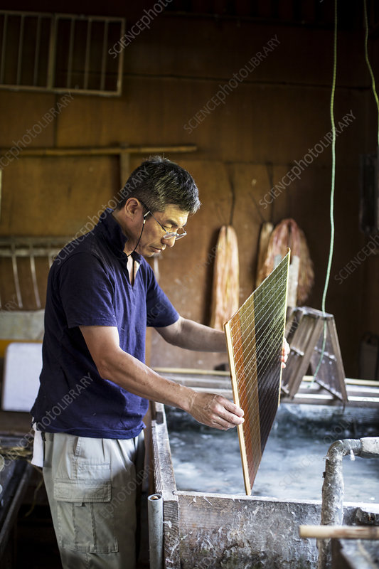 Japanese man in a workshop making Washi paper