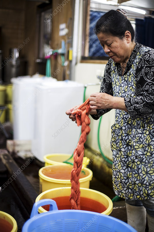 Japanese woman standing in a textile plant dye workshop