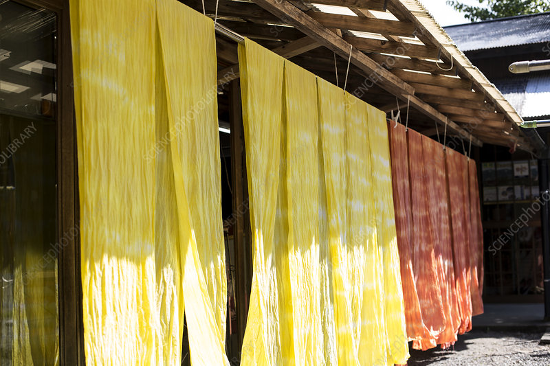 Bright yellow and orange fabric hanging outside