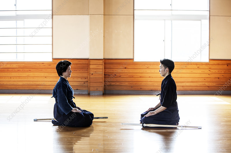 Japanese Kendo fighters kneeling opposite each other