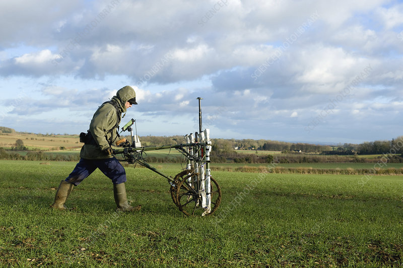 A geophysicist creating a geophysical survey of a field