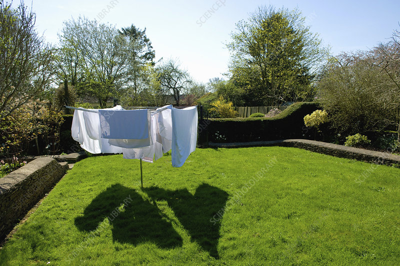 A rotary washing line with laundry drying in the sun