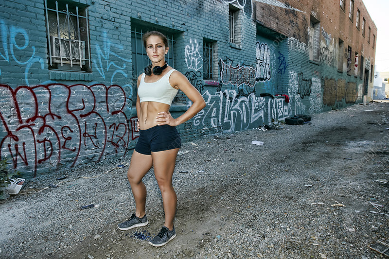 Female athlete standing on a street