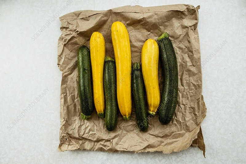 Yellow and green courgettes displayed
