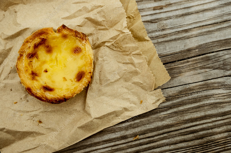 A homemade baked tart on a brown paper bag
