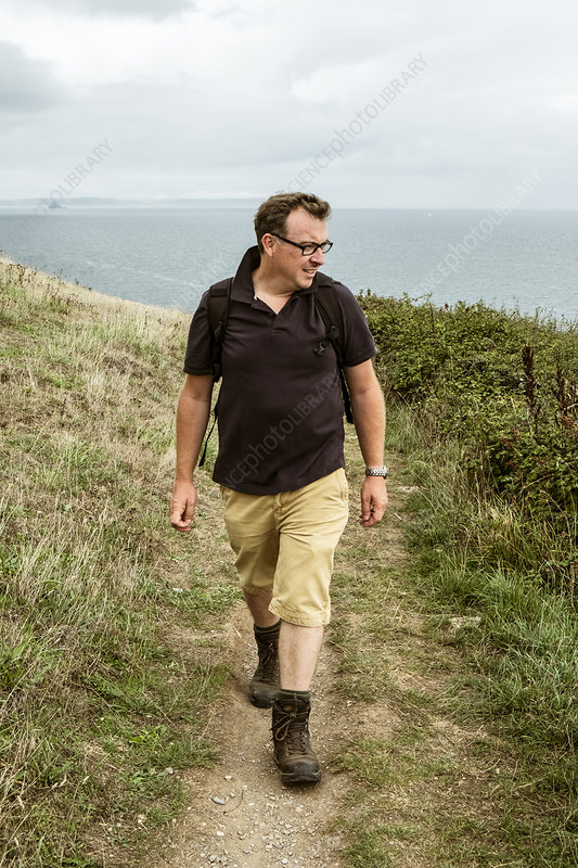 A man in walking boots with a rucksack