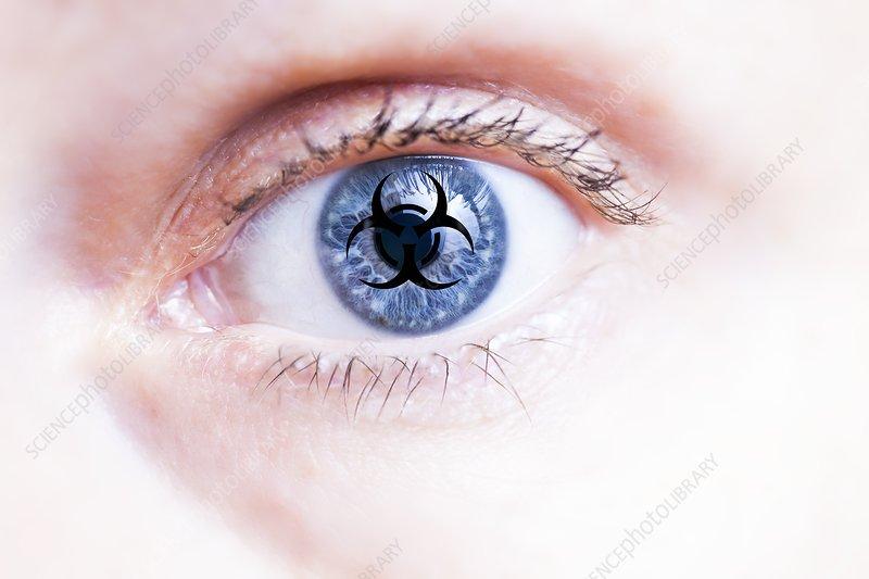 Human eye and biohazard sign, conceptual image