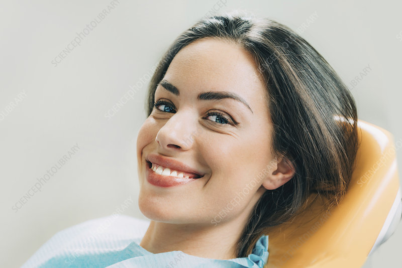 Female patient sitting in dentist's chair