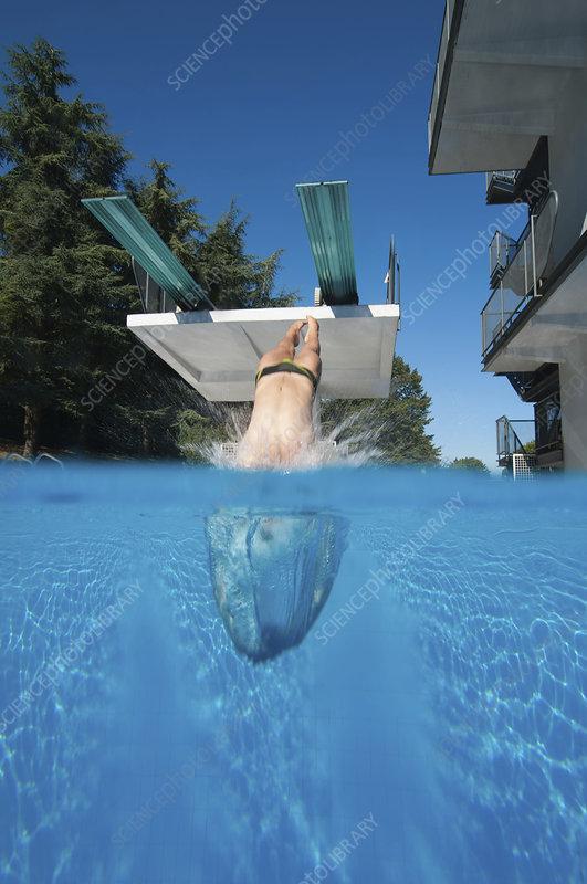 Diver entering water