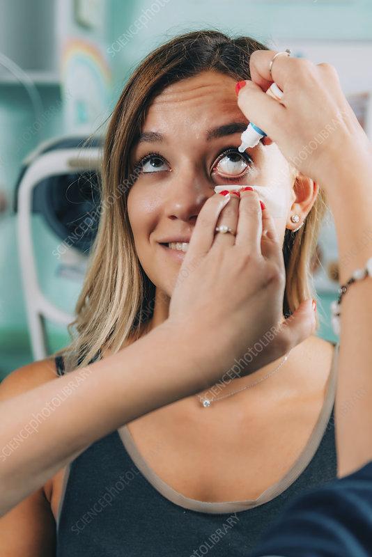 Ophthalmologist applying eye drops
