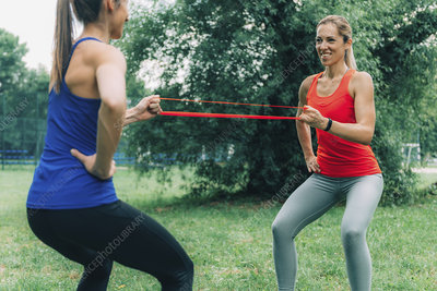 Women exercising with elastic bands