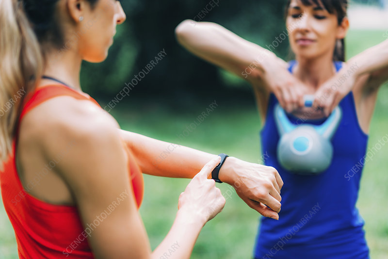 Woman looking at smartwatch during workout