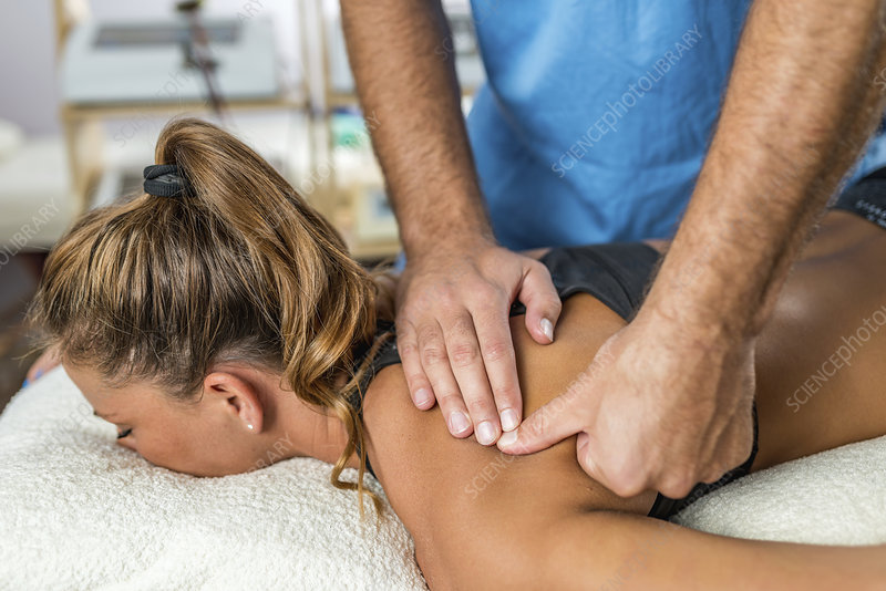 Osteopathist treating woman's back