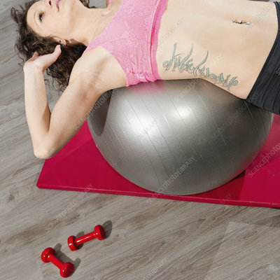 Stretching on fitness ball
