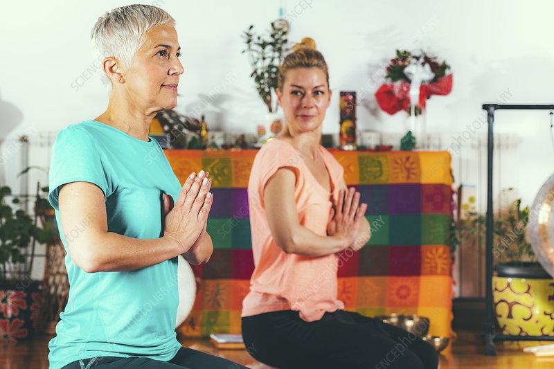 Senior woman in private yoga class