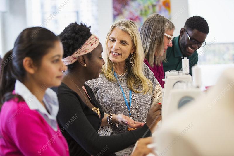 Fashion designers talking, working at sewing machines