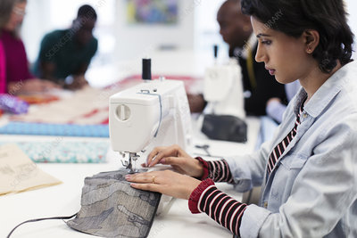 Fashion Designers Using Sewing Machines Search Science Photo Library