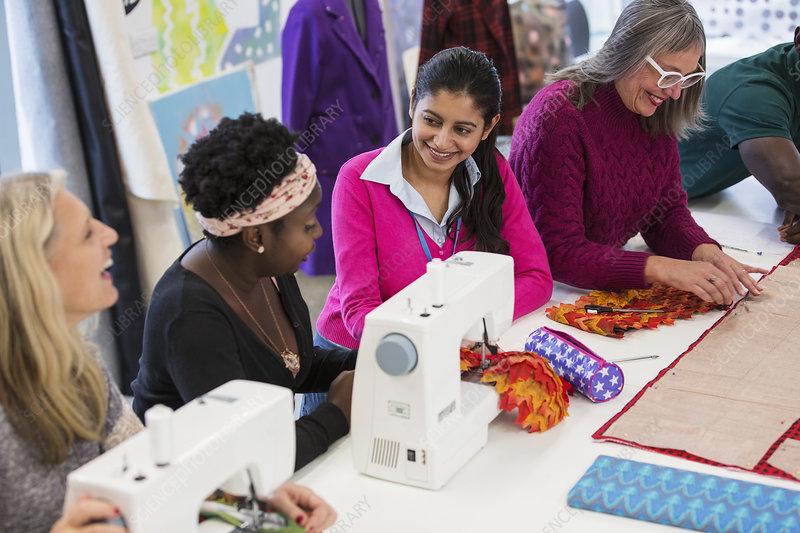 Fashion designers using sewing machines