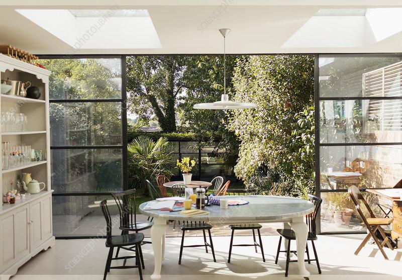 Kitchen table and patio doors open to garden
