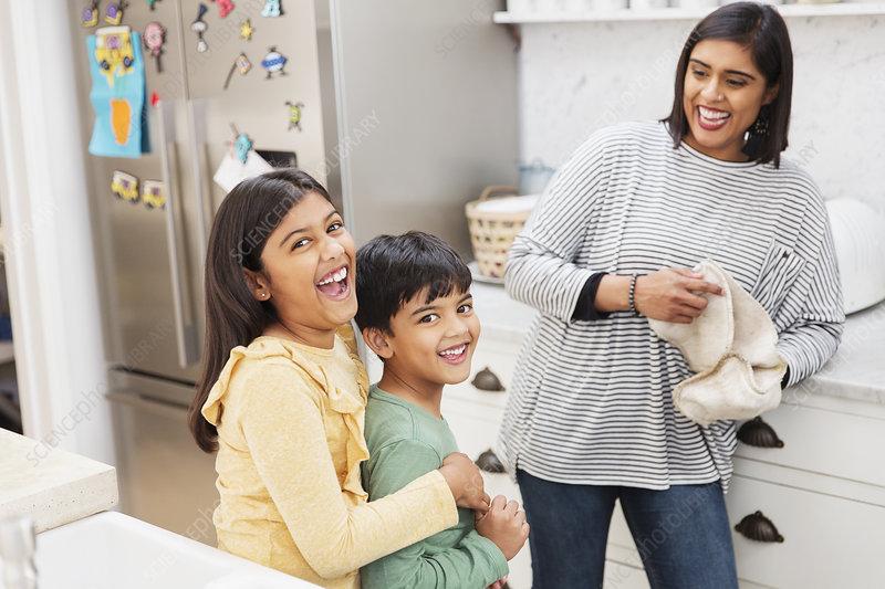 Portrait mother and children in kitchen