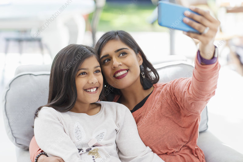 Happy mother and daughter taking selfie