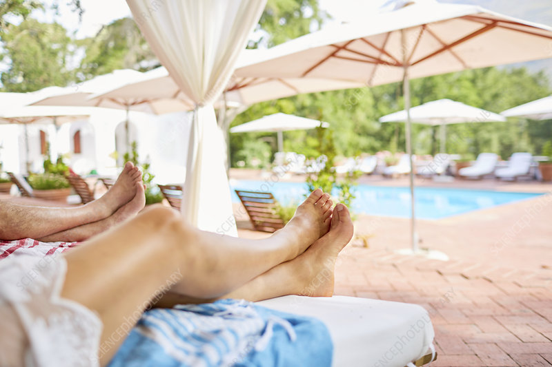 Couple relaxing at resort poolside