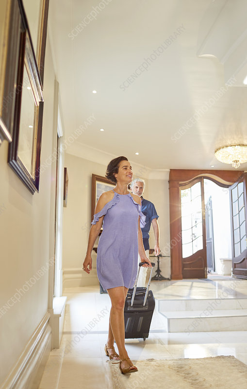 Mature couple with suitcase arriving at hotel