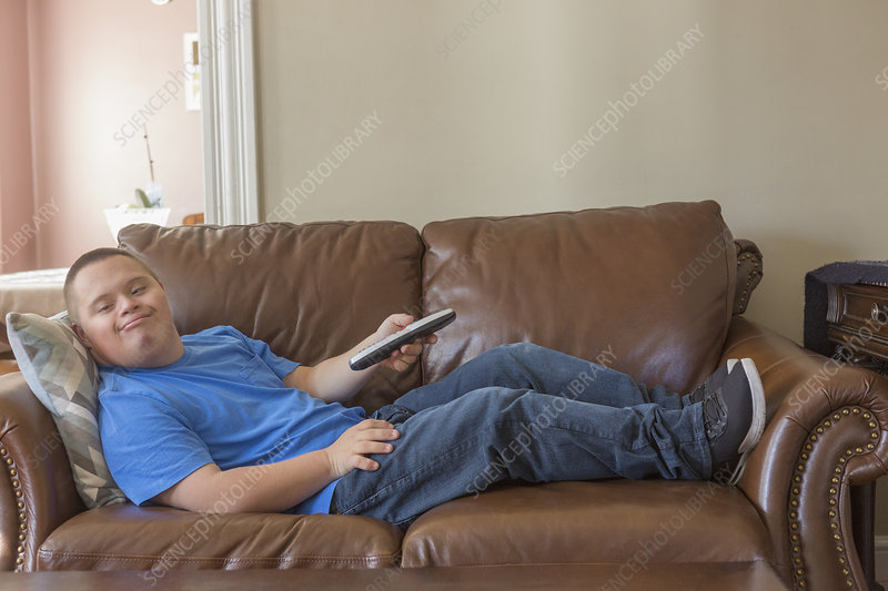 Teen with Down Syndrome watching TV