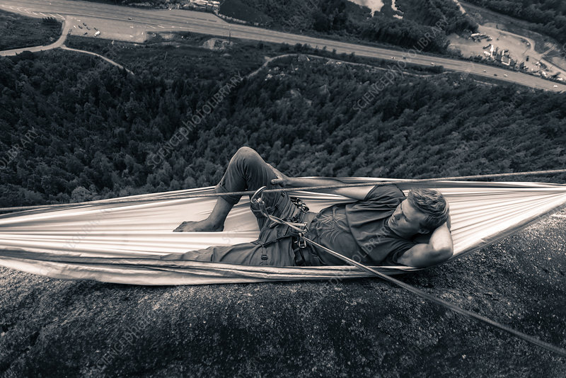 Young male climber reclining in hammock