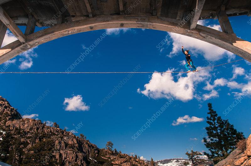 Woman highlining, California, USA