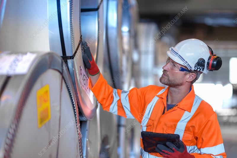 Worker using digital tablet at port