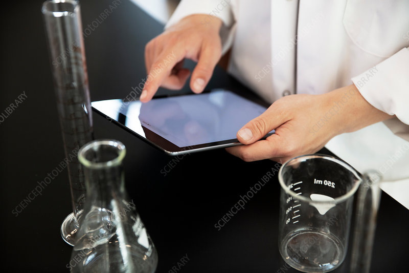 Laboratory worker using digital tablet